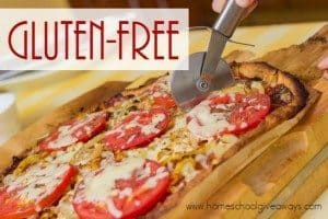 Cutting paleolithic vegetarian freshly baked homemade pizza, closeup