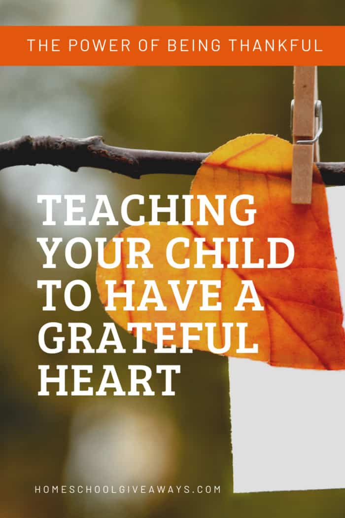 image of heart shaped leave clipped to twig with text overlay. Teaching YourChild to Have a Grateful Heart from www.Homeschoolgiveaways.com