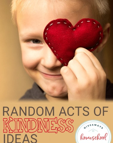 young boy holding handmade heart with overlay - Random Acts of Kindness Ideas for Kids